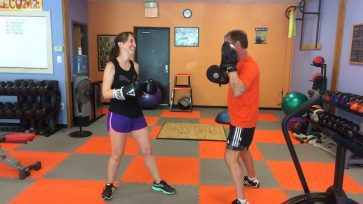 Client training with boxing focus mitts develops anaerobic endurance and strength.