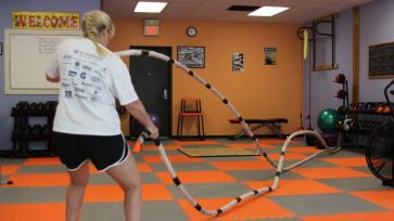 Client training with heavy ropes develops anaerobic fitness and core strength.