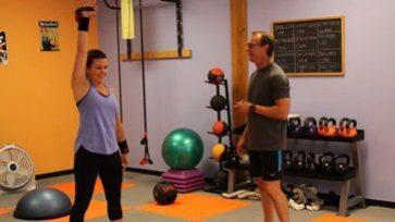 Reviews - Client practices kettlebell snatches with a 20lb kettlebell.